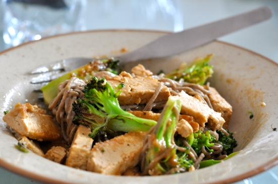 Tofu, broccoli & soba noodles covered in a delicious peanut sauce